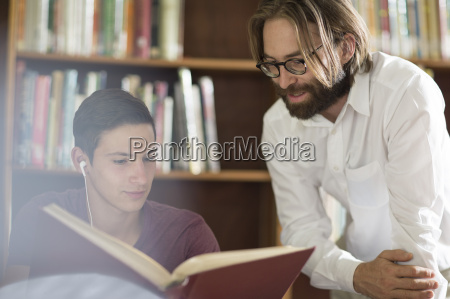 high school student in library with