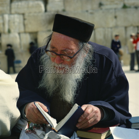 old man with prayer book at