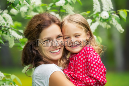 mother and little daughter in spring