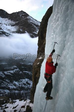 an ice climber makes his way