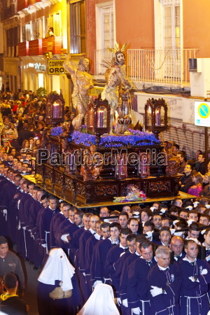 religious float being carried through the
