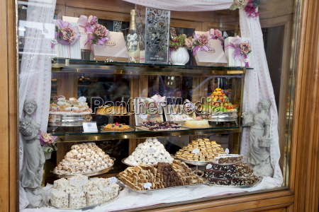 cakes sweets andpastries in shop window