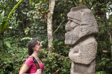 an ancient stone statue san agustin