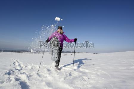 germany bavaria mature woman kicking snow