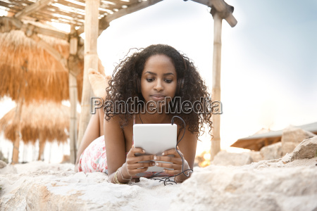 young woman with headphones and digital