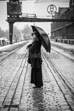 germany berlin woman with umbrella watching