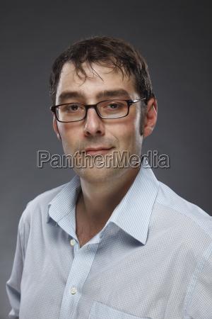 portrait of smiling man wearing glasses
