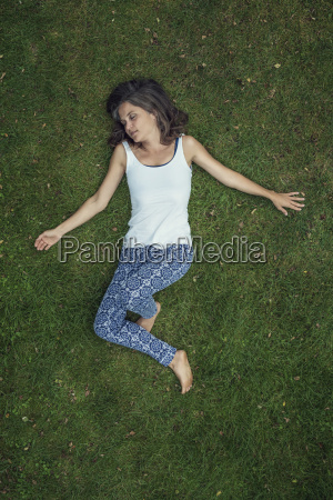 woman lying on a meadow with