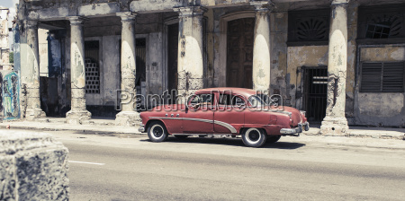 cuba red vintage car parking in