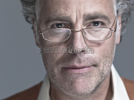 man wearing eye glasses looking serious