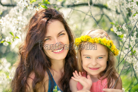 mother and daughter in sunny park