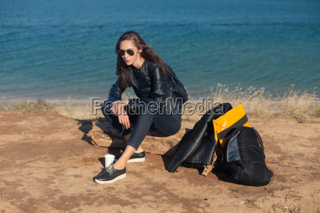 travel concept young woman with sunglasses