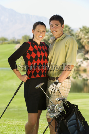 golf couple standing together on course