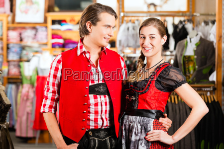 couple is trying dirndl or lederhosen