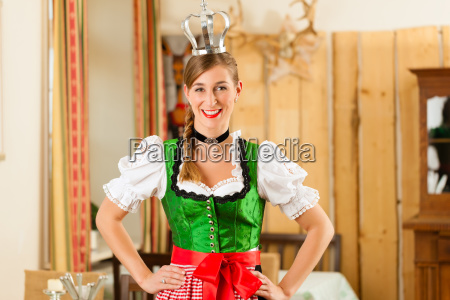 young woman as queen in traditional