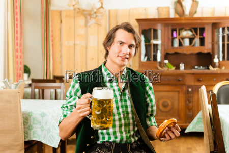 young man in traditional bavarian tracht