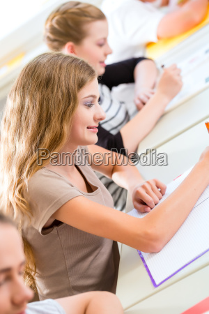 students writing a test in school