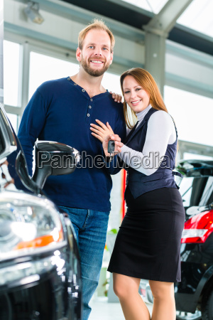 young people or couple with auto