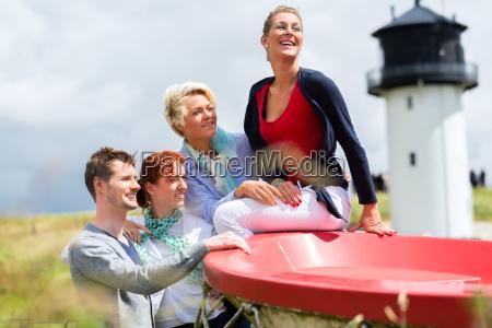 friends enjoying vacation at north sea