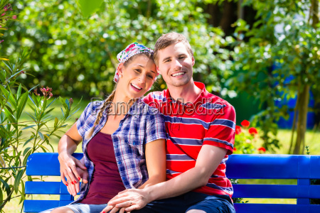man and woman in garden sitting
