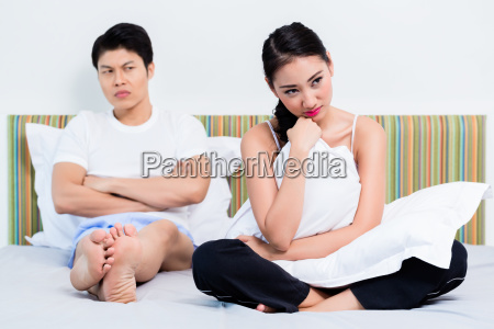 alienated chinese couple woman is rejecting