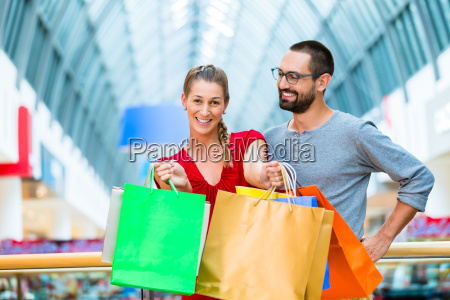man and woman in shopping mall