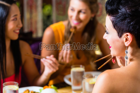young, people, eating, in, asia, restaurant - 21487909