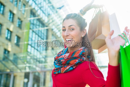 woman shopping with bags in city