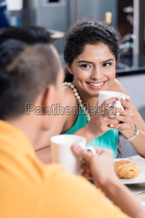 indian couple having breakfast in the