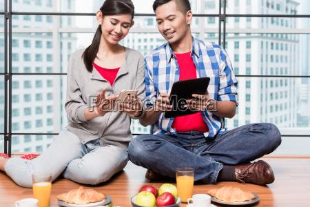 young indonesian couple having breakfast