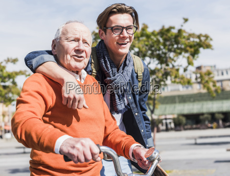 senior man with adult grandson in