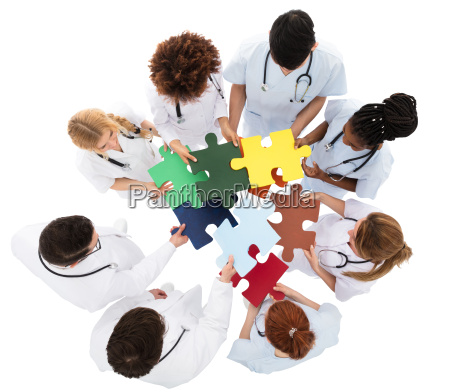 medical team solving jigsaw puzzle