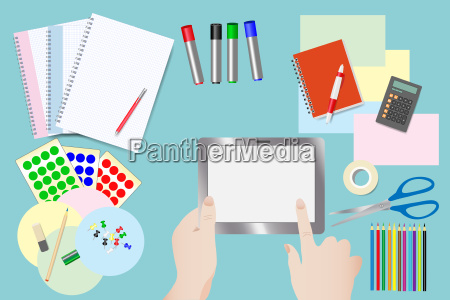 touching tablet over equipment for education