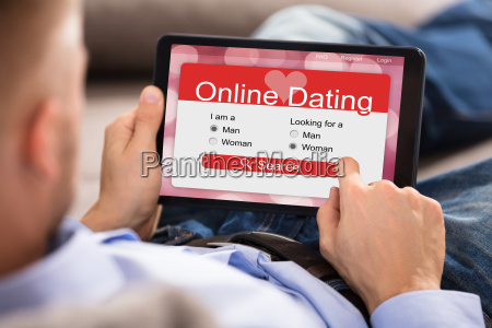 man using online dating application on