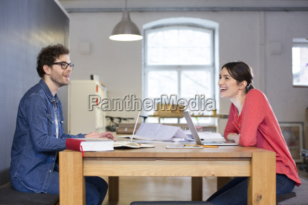 happy man and woman working on