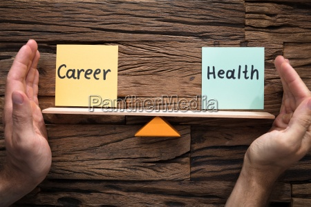 hands covering balance between career and