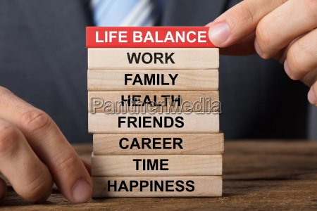businessman building life balance concept with