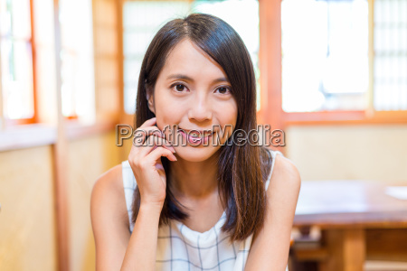 young asian woman in japanese restaurant