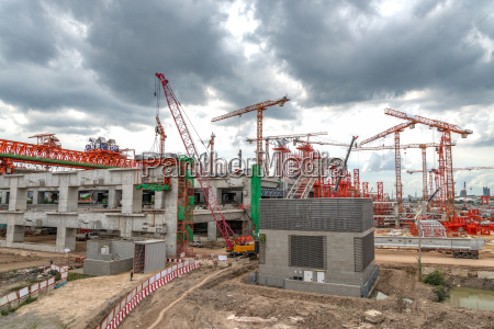 cranes on construction site expressway in