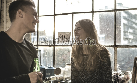 smiling young woman and young man
