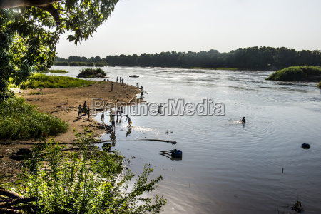local people playing in the waters