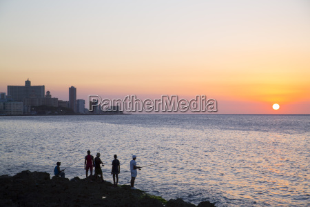 locals fishing from the malecon in