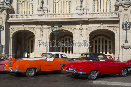vintage cars in front of grand