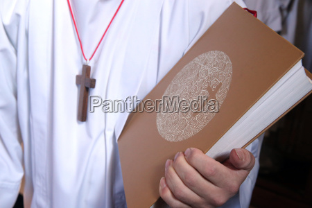 altar boy with holy bible during