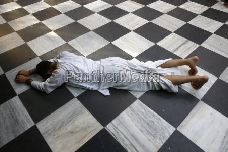 hindu devotee prostrating at krishna balaram
