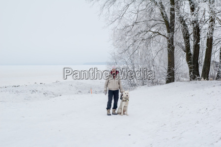 woman walking with a dog in