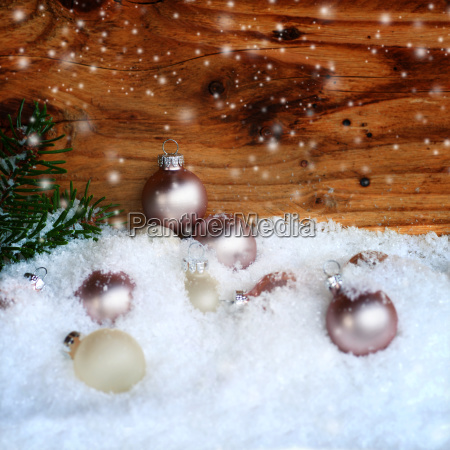 christmas balls in snow