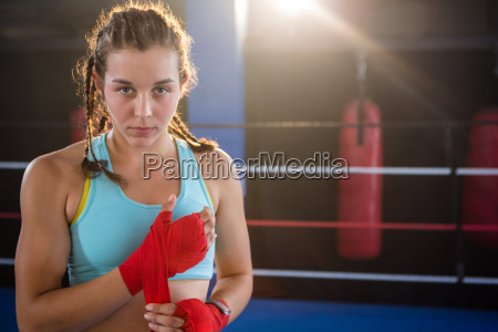 portrait of young female athlete wrapping