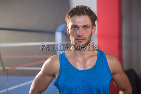 portrait of young male athlete standing
