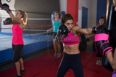 young female boxers practicing boxing by